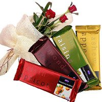 Deliver 3 Red Roses with 4 Cadbury Temptation Chocolates to Bengaluru incorporate with New Year Flowers in Bangalore