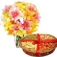 Online Gifts Deivery in Bengaluru to deliver 10 Mix Lily Vase, 1 Kg Mix Dry Fruits
