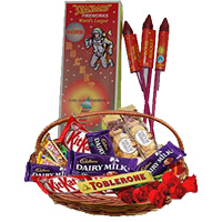 Basket of Assorted Chocolates and 10 Red Roses with 1 Box Rocket contain 10pcs. Diwali Gifts in Bangalore.