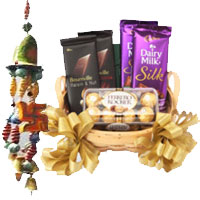 Cheap Online Diwali Gifts to Bangalore including Door Hanging 2 with Silk, Bournville and Ferrero Rocher Chocolate Basket.