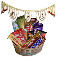 Send Diwali Gifts in Mysore containing Door Hanging Bandhanwar 1 with Assorted Chocolate Basket.