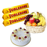 Online 500gm Pineapple Cake with 1 Kg Fresh Fruits Basket and Toblerone Chocolates as gifts in Bangalore