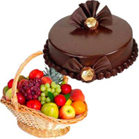 Diwali Gifts to Bengaluru be add up to 1 Kg Fresh Fruits to Bengaluru in Basket with 500 gm Chocolate Truffle Cakes Bengaluru