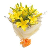 Online Flower Delivery in Bangalore of Yellow Lily Bouquet 7 Flowers to Bangalore Bannerghatta Road