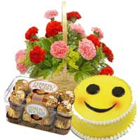 Send 15 Red Pink Carnation Basket Bangalore, 16 pcs Ferrero Rocher and 1 Kg Smiley Cake to Bangalore